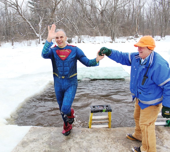 Marathon County Administrator Brad Karger being helped out of the water by Gary Beastrom, event volunteer and County Board Member.