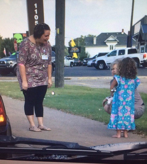 Helping_Child_on_Grand_Ave