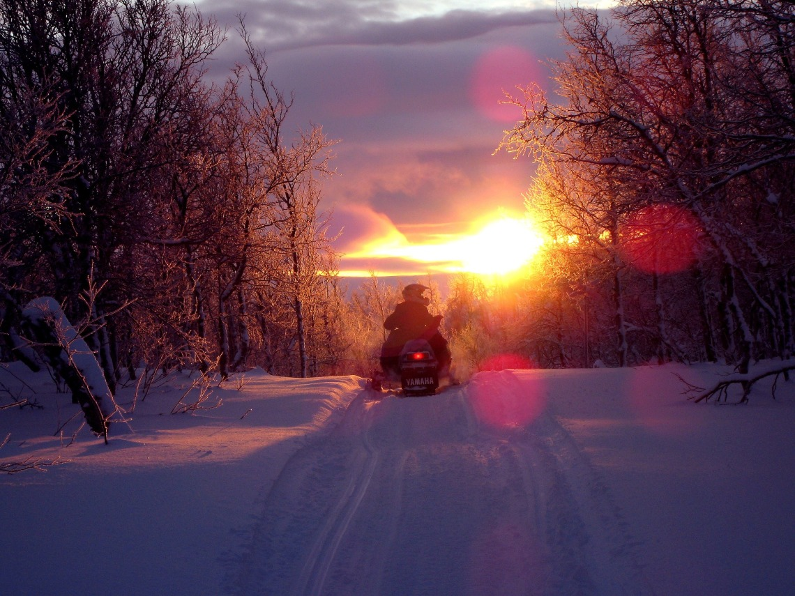 Snowmobiling_at_Sunset