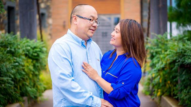 Dr. Maysee Yang Herr and her husband, Asia Herr.