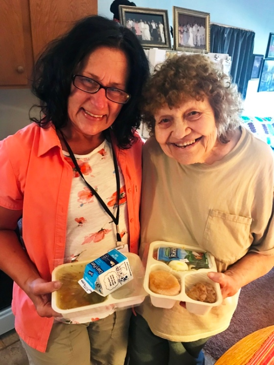 Volunteer_Laura_Malzahn_Delivering_Meals_On_Wheels_to_Romelle