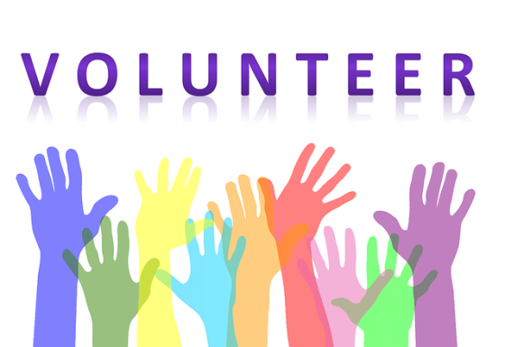 volunteer-hands-in-air