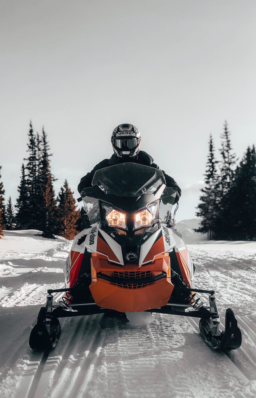 photo of person riding snowmobile